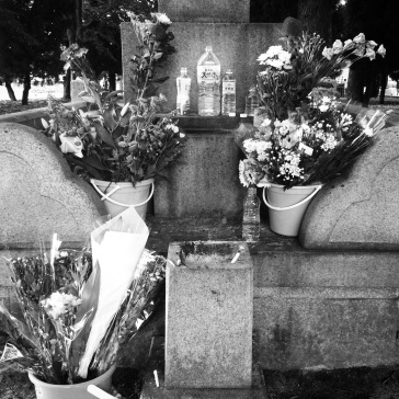 Water and flowers for the victims
