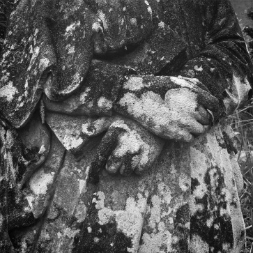 Clasped hands of a statue that survived the blast