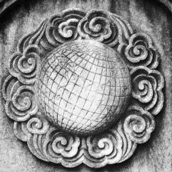 World symbol on a headstone