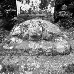 There were 5 stone turtles like this, holding up some kind of monument