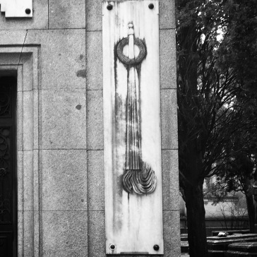 Inverted torch on mausoleum