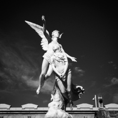 White statues, black sky: when sunny days work in a cemetery
