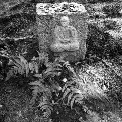 Square stone near entrance
