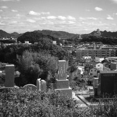 View from the newer cemetery. You can see Himeji Castle in the distance (top right).