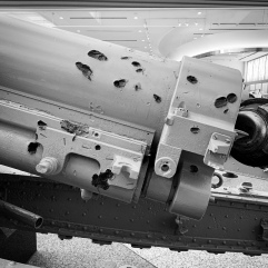 Bullet holes on gun