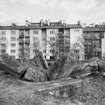 Soviet-era apartment blocks next to the camp. The ruins of Jewish funeral parlour are in the foreground.