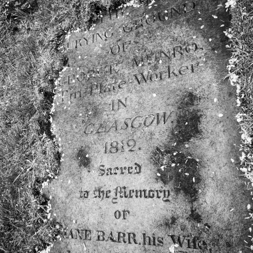 Gravestone of a tinsmith buried in the ground