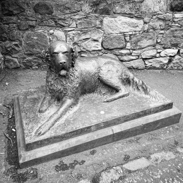 Statue of a dog outside the cemetery